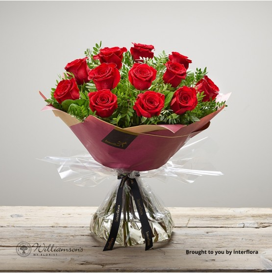 12 red roses gift wrapped for delivery in the UK