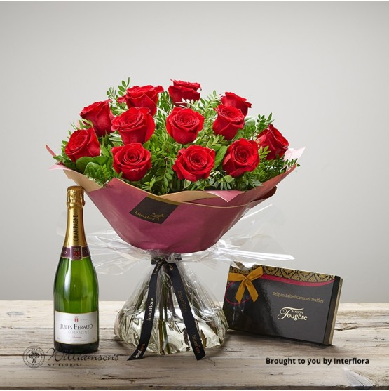 Red roses champagne and chocolates.