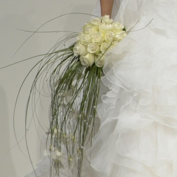 White rose and bairegrass and pearls bridal bouquet