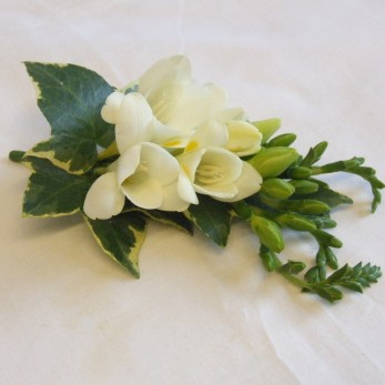 Ladies small simple Freesia And Ivy Corsage