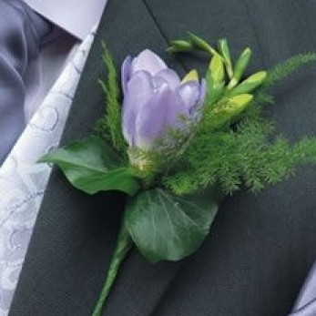Gents freesia buttonhole